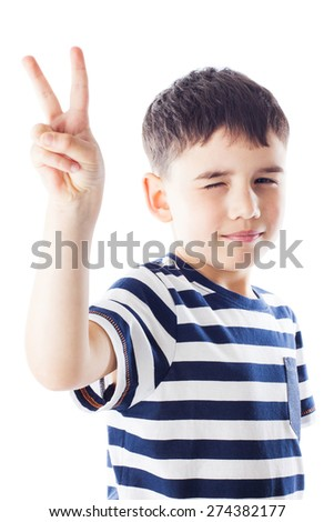 Portrait of smiling boy, he shows hand victory sign - stock photo