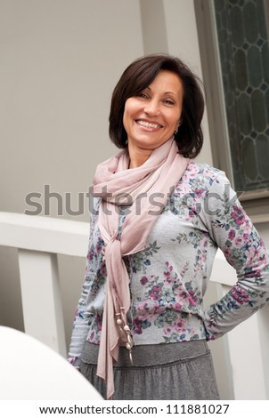 Portrait of smiling brunette woman in Old town - stock photo