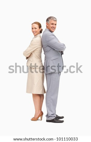 Portrait of smiling business people back to back against white background - stock photo