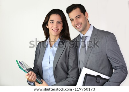 Portrait of smiling business people in grey suit - stock photo