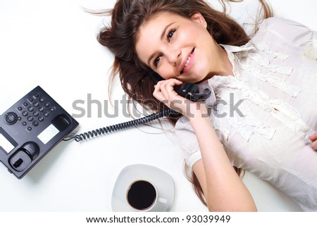 Portrait of smiling business woman on phone call - stock photo