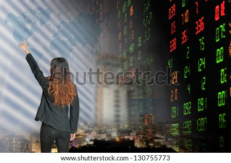 Portrait of smiling business woman . over stock exchange background - stock photo