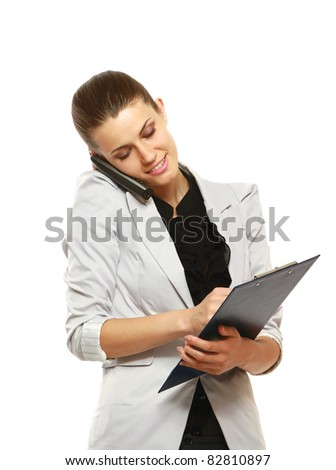 Portrait of smiling business woman using cell phone and taking notes isolated over white background - stock photo