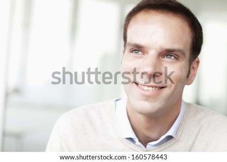 Portrait of smiling businessman in casual clothing looking away - stock photo