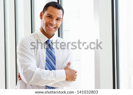 Portrait Of Smiling Businessman In Office - stock photo