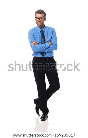 Portrait of smiling businessman wearing glasses looking at side  - stock photo