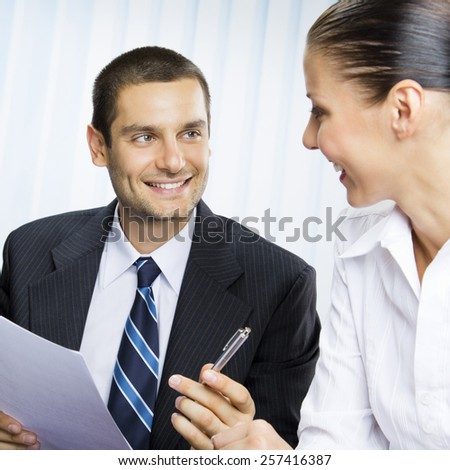 Portrait of smiling businesspeople or client and businessman, giving pen for signing document, at office - stock photo