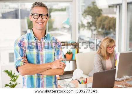 Portrait of smiling casual designer in front of his working colleague in the office - stock photo