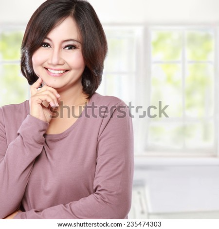 portrait of smiling casual middle aged woman - stock photo