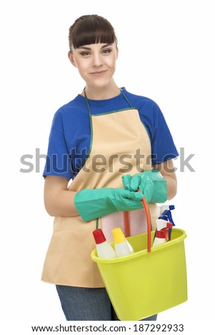 Portrait of Smiling Caucasian Housewife Holding Cleaning Gear. isolated On White. Vertical Image - stock photo