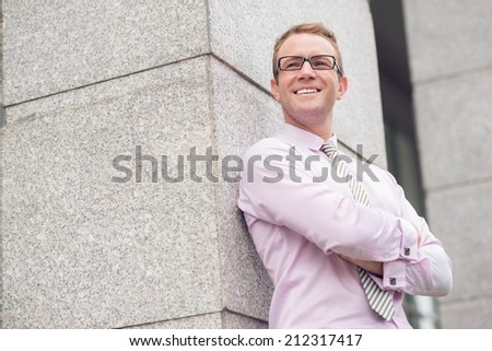 Portrait of smiling confident businessman with his arms crossed - stock photo
