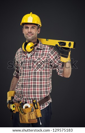 Portrait of smiling construction worker - stock photo