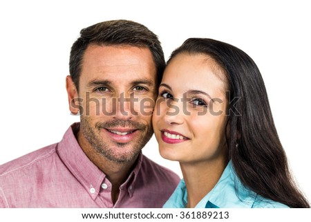 Portrait of smiling couple looking at camera on white background - stock photo