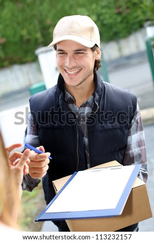 Portrait of smiling delivery man - stock photo