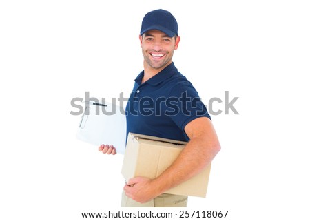 Portrait of smiling delivery man with cardboard box and clipboard on white background - stock photo