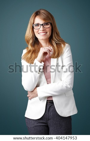 Portrait of smiling executive businesswoman standing at isolated background.  - stock photo