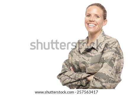 Portrait of smiling female airman against white background - stock photo