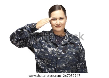 Portrait of smiling female navy officer saluting against white background - stock photo