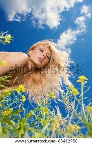 portrait of smiling girl in blue sky - stock photo