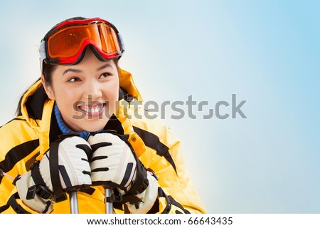 Portrait of smiling girl with sport glasses looking aside - stock photo
