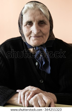 Portrait of smiling grandmother, looking at camera - stock photo