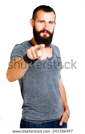 Portrait of smiling handsome Tattooed bearded man pointing at you over white background - stock photo