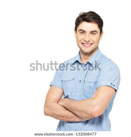 Portrait of smiling happy handsome man in blue casual shirt - isolated on white background - stock photo