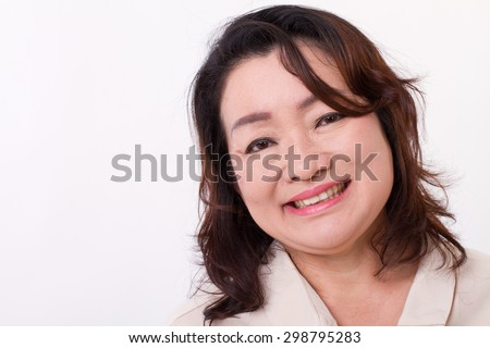 portrait of smiling, happy middle aged woman - stock photo