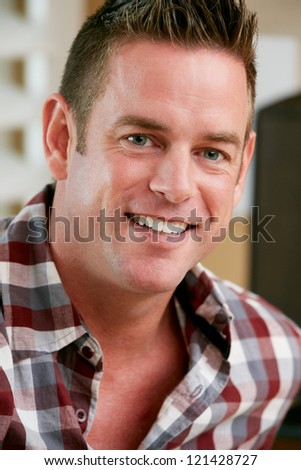 Portrait Of Smiling Man At Home - stock photo