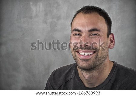 portrait of smiling man on gray background - stock photo