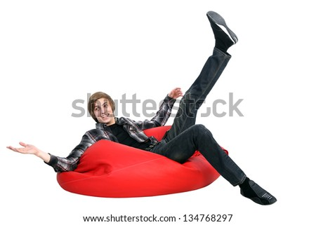 Portrait of smiling man sitting on bean bag. White background. - stock photo