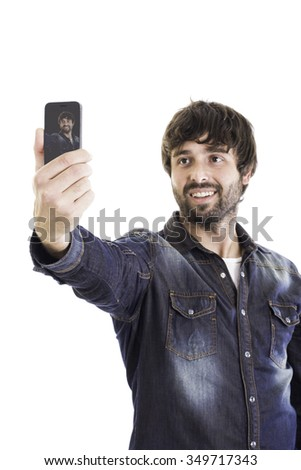 Portrait of smiling man taking photo of himself 