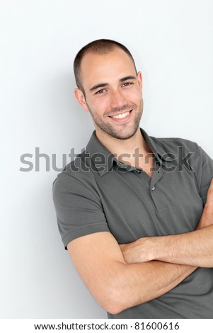 Portrait of smiling man with arms crossed - stock photo