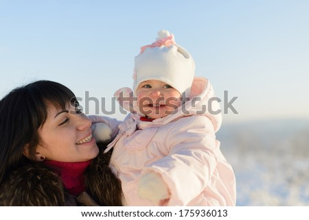 portrait of smiling mother and daughter in park - stock photo