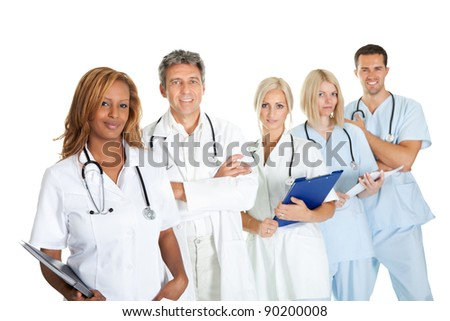 Portrait of smiling multiethnic medical team against white background - stock photo