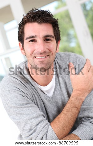 Portrait of smiling relaxed man - stock photo