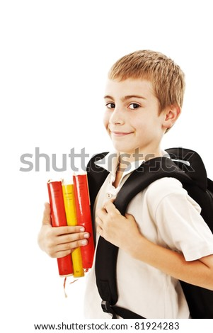 Portrait of smiling schoolboy with rucksack holding books - stock photo