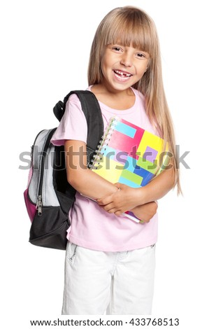 Portrait of smiling schoolgirl with school bag and books, isolated on a white background - stock photo