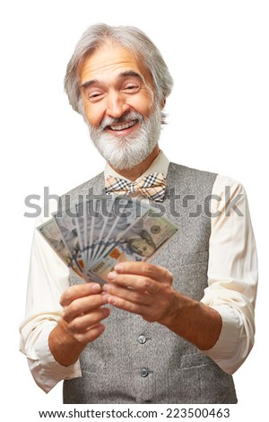 Portrait of smiling senior caucasian gentleman with a grey beard and bowtie holding money isolated on white background. - stock photo