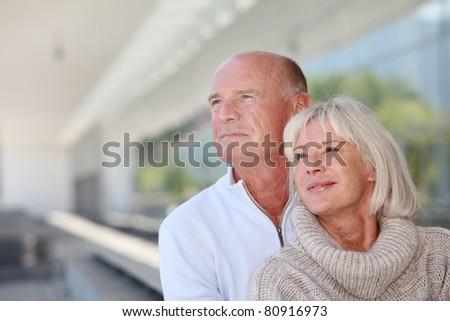 Portrait of smiling senior couple - stock photo