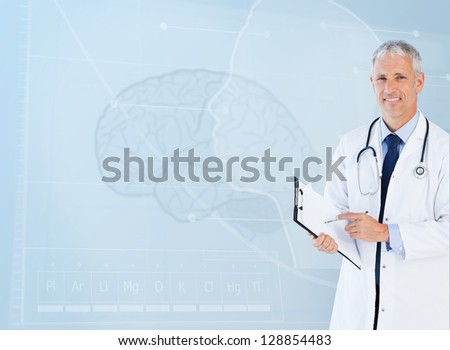 Portrait of smiling senior doctor using a clipboard - stock photo
