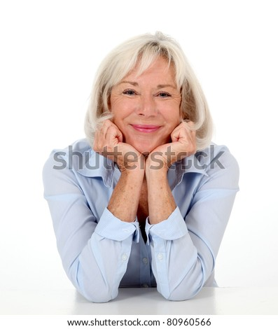 Portrait of smiling senior woman with blue shirt - stock photo