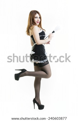 Portrait Of Smiling Sexy Maid Standing On One Leg Over White Background In Pin Up Style - stock photo