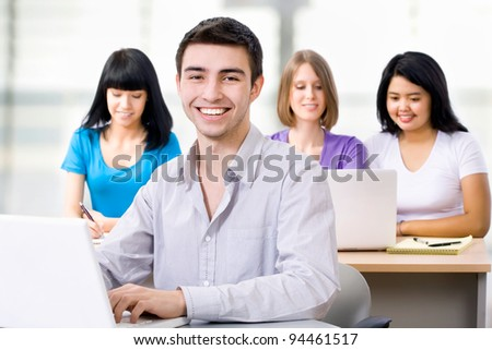 Portrait of smiling student in training course - stock photo