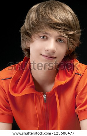 Portrait of Smiling Teenage Boy Looking at the camera - stock photo