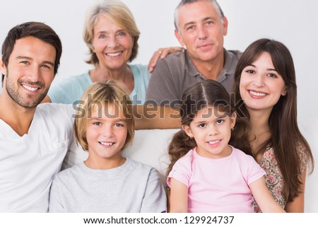 Portrait of smiling three generation family - stock photo