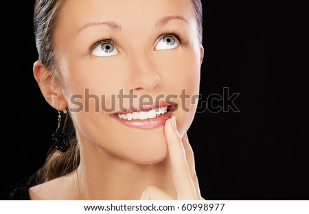 portrait of smiling visionary girl on black - stock photo