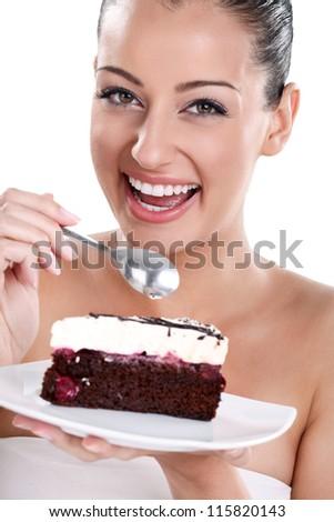 Portrait of smiling woman eating cake, isolated on white background - stock photo