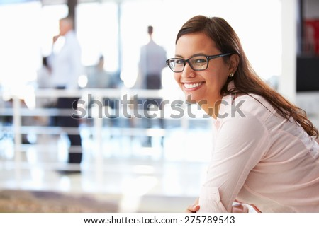 Portrait of smiling woman in office - stock photo