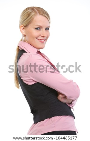 Portrait of smiling woman with crossed arms - stock photo